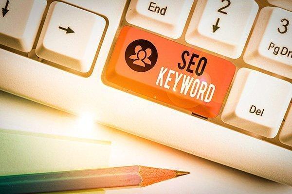 """Keyboard key that says, """"S-E-O Keyword"""". Devadigm offers a SEO keyword analysis."""