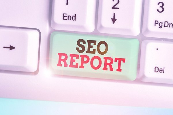 "Keyboard key that says, ""S-E-O Report"". Devadigm offers a detailed website SEO Report."