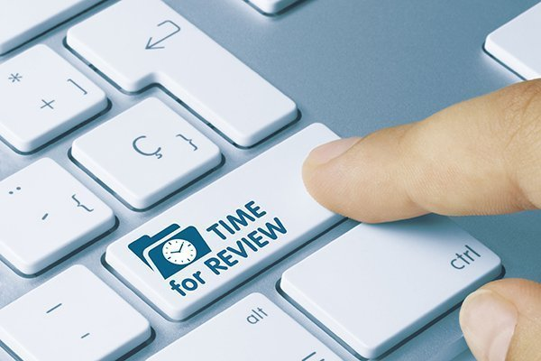"Keyboard key that says ""Time for a Review"". Devadigm offers an in depth review of a website and its SEO rankings."