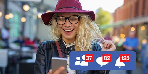 Woman inviting friends to like her Facebook page