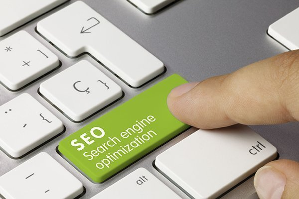 "Keyboard key that says, ""SEO Search Engine Optimization"", which is a service offered by Devadigm."